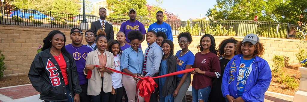 Students participate in a ribbon cutting ceremony.