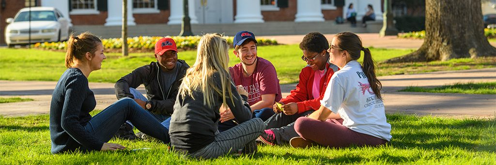 A group of students spend time with one another near the Lyceum.